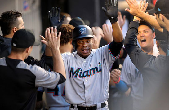 Miami Marlins outfielder Curtis Granderson, a T.F. South graduate, is congratulated in the dugout after hitting a two-run homer against the White Sox at Guaranteed Rate Field on Tuesday, July 23, 2019.