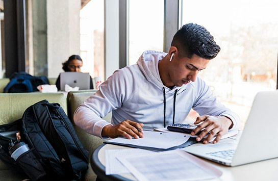 Male UIC student studying