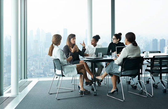 Businesswomen having a meeting in a boardroom