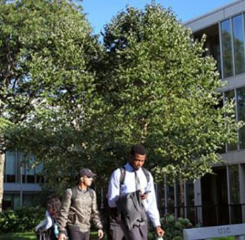 UIC students walking in front of Douglas Hall